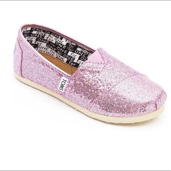58e9a6d1ccfa Toms Girls Pink sparkle slip ons. Toms. M_5bcb35d0de6f623ab4cc67b4.  M_5bb84046c9bf500c4825de61. M_5bb84047bb7615f2505e084d.  M_5bb840492e1478c0d0e28e23